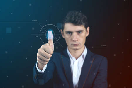Man passing biometric verification with fingerprint scanner, service of security and protection, concept futuristic technology