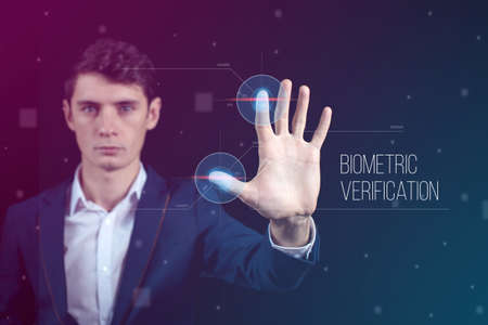 biometric: Man passing biometric identification with fingerprint scanner, service of security and protection, concept futuristic technology Stock Photo