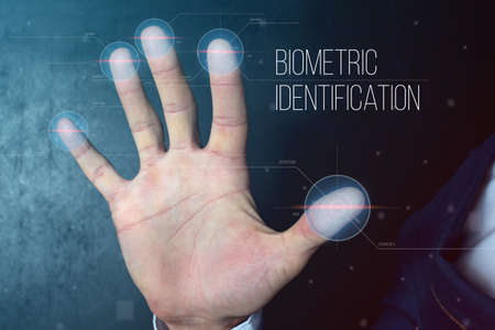 Man passing biometric identification with fingerprint scanner, service of security and protection, concept futuristic technology Stock Photo