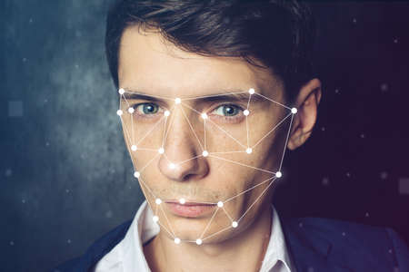 Biometric verification. Face recognition on polygonal grid is constructed by the points 版權商用圖片