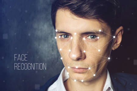 Biometric verification. Face recognition on polygonal grid is constructed by the points Stockfoto