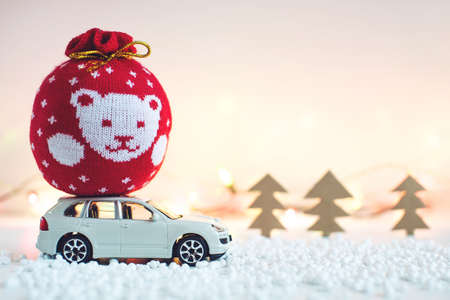 desk toy: Toy car carries on the roof gift for Christmas and the new year Stock Photo