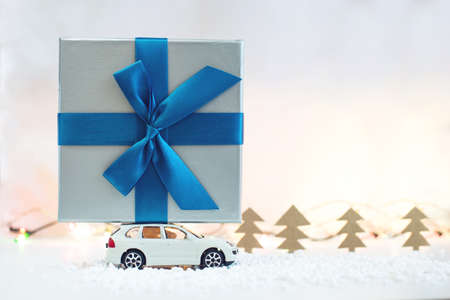 Toy car carries on the roof gift for Christmas and the new year Stock Photo