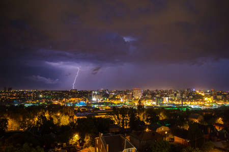 beautiful view of the lightning in the night city in clouds