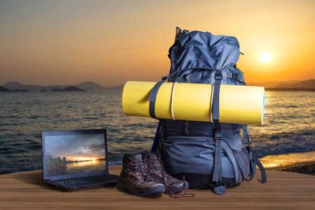 Backpack trekking shoes, notebook. traveler equipment, concept of travel Stock Photo