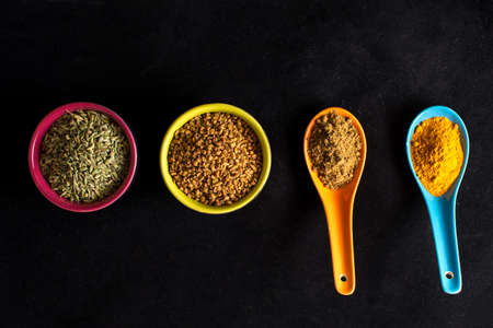 Colorful Indian spices on black background Stock Photo
