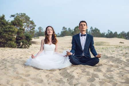 Couple on the beach on the olkhon. Yoga