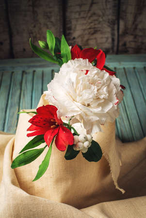 sugarpaste: a beautiful bouquet of Roses from mastic, good flowers made of sugar on wooden background in rustic style, food design