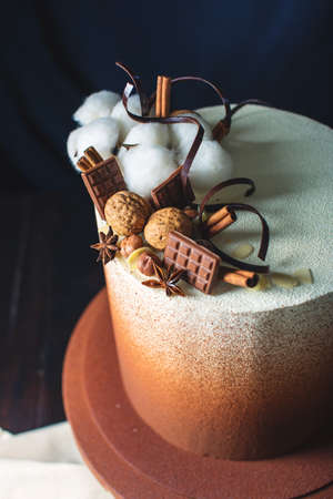 Wedding chocolate cake dusted with cocoa and nuts, cinnamon and chocolate on top. trends for wedding desserts, foot design Stock Photo