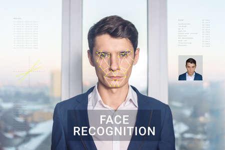 El reconocimiento de una cara masculina por capas de una malla y el cálculo de los datos personales por el software. verificación biométrica y la identificación