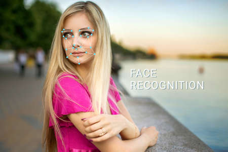 facial features: Recognition of a female face by layering a mesh and the calculation of the personal data by the software. Biometric verification and identification