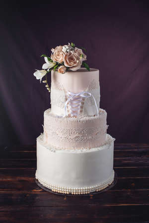 Beautiful Three-tiered Wedding Cake In The Form Of Dresses With ...