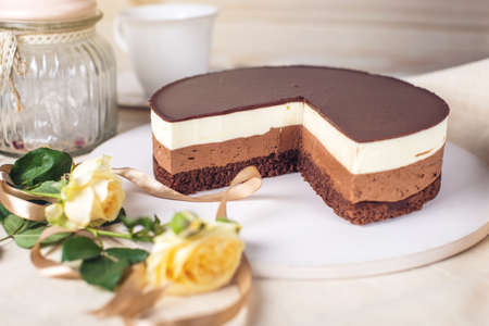 teaparty: Chocolate mousse cake made of three different chocolate mousse layers , white , milk and dark with chocolate. Delicious homemade dessert. Stock Photo