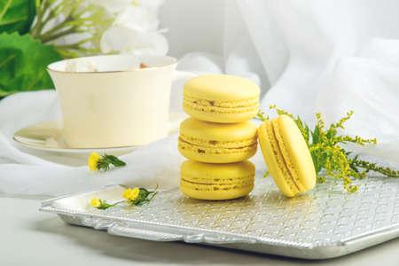 Yellow banana macarons. French delicate dessert for Breakfast in the morning light