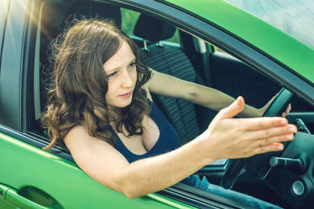 Angry and frustrated woman driver in the car. The quarrel and dissatisfaction on the way. Stock Photo