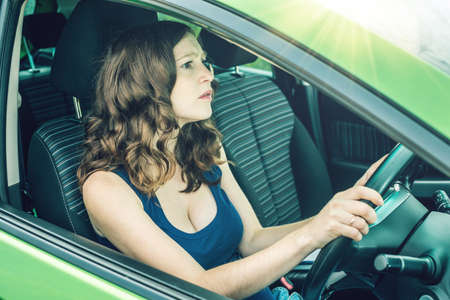 Woman in the car. Hands on the wheel. Focused and tense. The lesson in driving school. Stock Photo