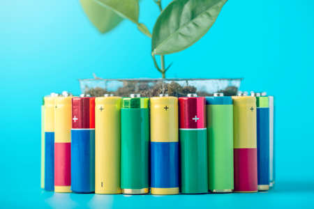 Recycling and disposal of alkaline batteries. The concept of energy friendly to the environment and ecology Stock Photo