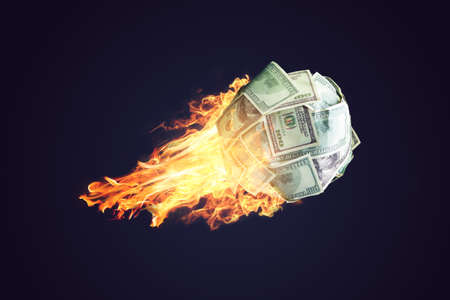 Fire money ball of dollar bills going up like a in space. The concept of the rapid development of financial profit