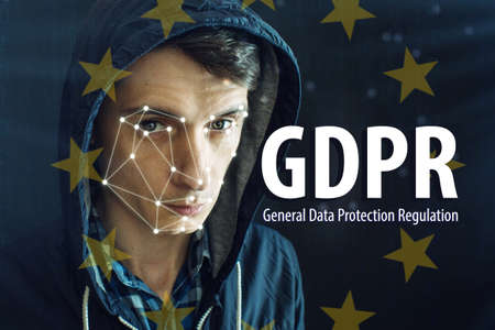 General Data Protection Regulation GDPR . The text with the EU flag in the background of men with personal identification data for facial recognition Stock Photo