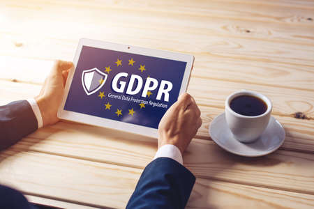 General Data Protection Regulation GDPR . The text with the EU flag depicted on the tablet