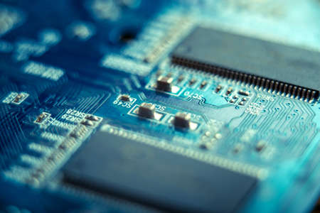 Electronic Board with the lines and chips, semiconductor elements closeup. The concept of the technology of solid-state microelectronics