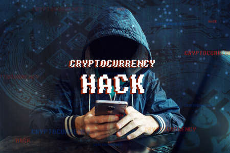 An anonymous hacker without a face is trying to steal cryptocurrency using a computer. Fraud and deception at Cryptojacking