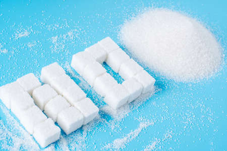 Text No is lined with sugar cubes. The concept of harm to the health of sweet and rejection of sucrose