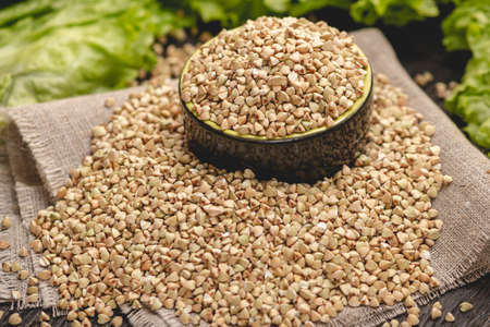 Seeds green buckwheat on a dark background. Vegan nutritious and healthy product. The concept of organic food