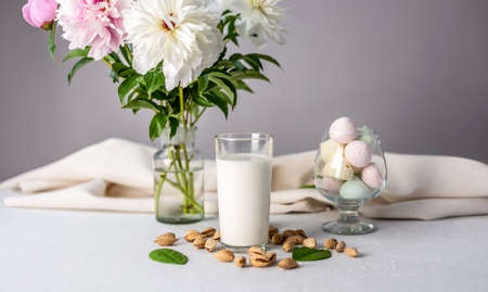 Vegetable natural almond milk on the table. Nutty alternative vegetarian drink for a healthy diet