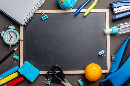 Stationery school supplies around the board. Top view and copy space. Concept of back to school. Stok Fotoğraf