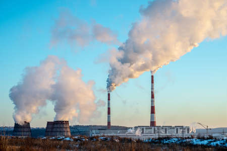 Environmental pollution and the problem of global warming due to the release of carbon dioxide into the atmosphere from the chimney of factories