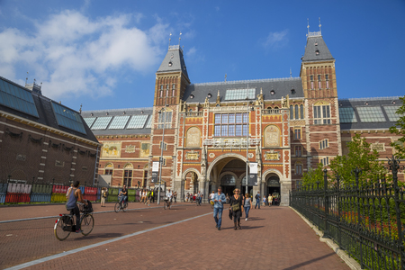 Amsterdam, The Netherlands - July 26, 2014: newly renovated Amsterdam Rijksmuseum The State Museum. The museum has on display 8,000 objects of art and history, from their total collection of 1 million objects from the years 12002000, among which are some  Editöryel
