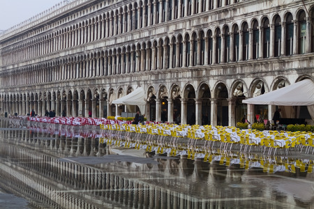 Venice, Italy - October 16, 2014: Empty cafe at the San Marco square during the flood. Local residents call this phenomenon aqua alta