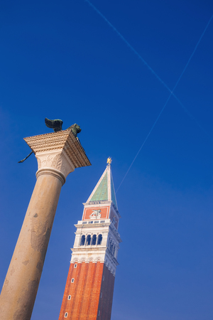 Intersecting traces of two planes in the sky in Venice over the area of ??San Marco square