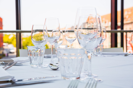 Empty glasses on a table covered with a white tablecloth