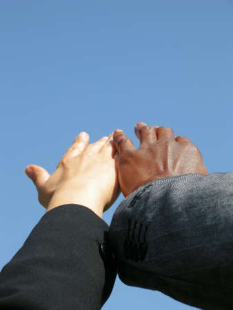 strive: Hands strive together towards the sky, cohesion