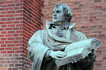 Martin Luther - sculpture of Martin Luther in front of St Marien Church Berlin, Germany