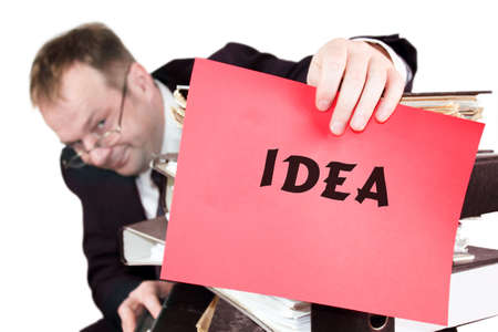 manage clutter: Idea - The man is holding a red sheet of paper on which he announces that he needs an idea