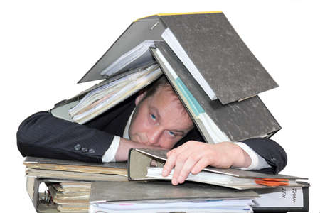 burn out: Burn Out - the man is buried under stacks of files