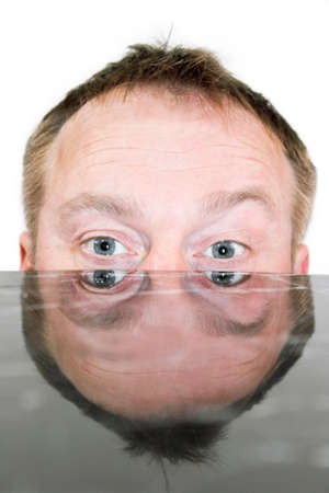 psychopathy: Psychose Psychosis - the man can only look over the table edge Stock Photo