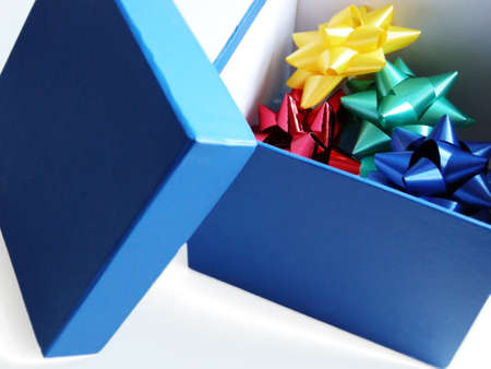 Blue gift box with ribbon flowers photo