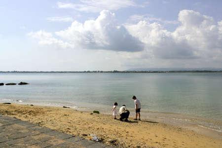 mensch: Small beach in Syracuse, Sicily