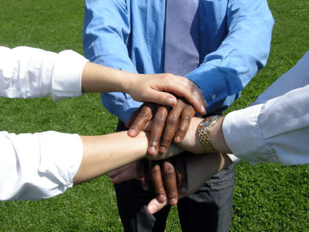 Cohesion - six hands are placed one
