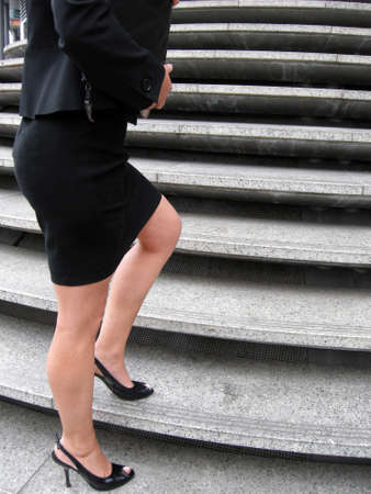 Steps of career - the woman climbs the career stages photo