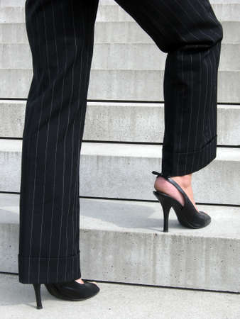 aspiration: Success Steps - Woman with high heels on the stairs of success Stock Photo