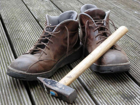 work shoes: Work shoes with a hammer