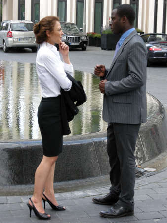 Business Talk - Man and woman stand opposite each other and exchange ideas Stock Photo - 10745733