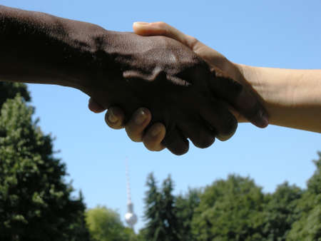 cohesion: Holding Hands - Hands symbolize support and cohesion Stock Photo