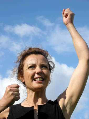 zest for life: Businesswoman clenches her fists and is optimistic