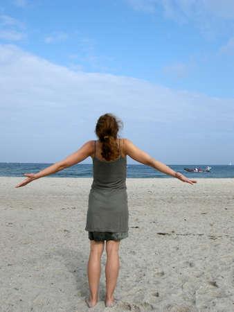 Freedom - Woman enjoys the time at sea Stock Photo - 10745727